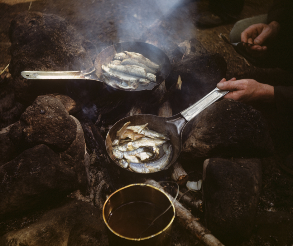 Cooking Fish In Cast Iron Over A Campfire